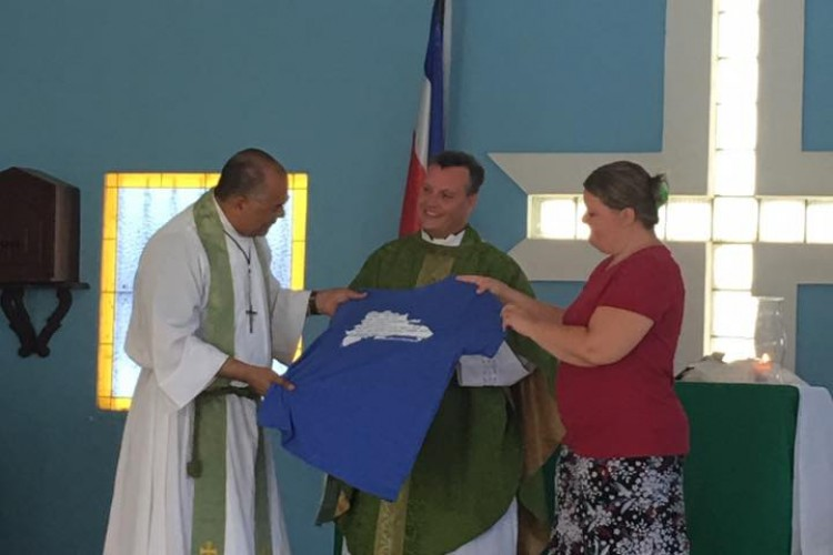 Presenting Fr. Vicente with an ECA Dream Team Shirt